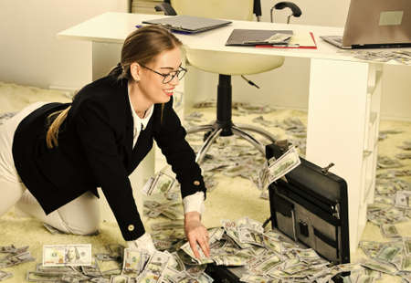 Woman counting money. Financial success. Tax service. Business investment. Office is littered with money. Business challenges. Owner of small business. Accounting and banking. Accountant office Reklamní fotografie