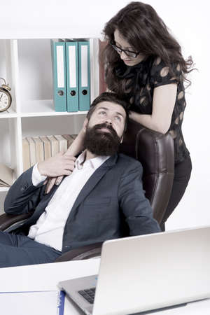 Love is everywhere. Love affair of businessman and sexy woman. Couple in love conducting affair at work. Boss and secretary having love relationship. Bearded man flirting with sensual woman in office 版權商用圖片