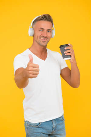 Best part of morning. Happy man give thumbs up to coffee. Approval gesture. Takeaway and cafe. Music technology. Modern lifestyle. Casual style. Every morning should be inspirational