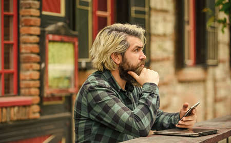 hipster inspired to work. agile business. mature student working on computer. go shopping on cyber monday. bearded man in cafe with laptop and phone. online distant education. Look at this