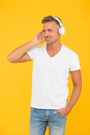 Listen better. Happy adult student wear headphones. Audio courses. Listentechnology. Listening comprehension. English school. Modern education. Break all language barriers