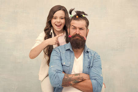 I did it. little girl made funny hairstyle for daddy. daughter and dad playing together. hairstylist her future career. father enjoying time with child. togetherness. spending time together at home Imagens