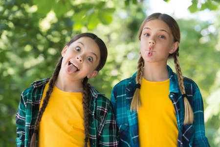 Grimacing mouths. Funny children have fun outdoors. Playing games. Leisure and free time. Active games. Enjoying childhood fun. Summer vacation. School holidays