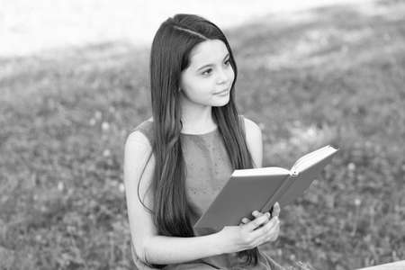 Fly high into imagination. Little child read book on summer day. Developoing imagination. Imagination and fantasy. Literature and poetry. Let your imagination explore, read more