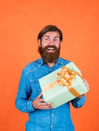 male go shopping. successful shopaholic in shirt. bearded man ready for holiday. sale and discount. mature hipster with beard hold present box. brutal caucasian hipster with gift