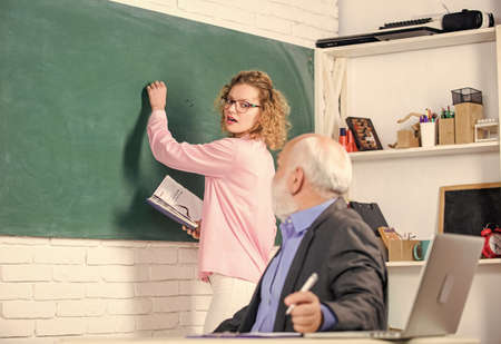 School education. Student learning in auditorium. senior teacher and woman at school lesson. pass exam. teachers room. student and tutor with laptop. student girl with tutor man at blackboard