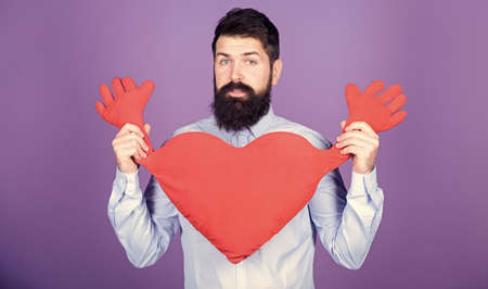 Guy with beard and mustache in love romantic mood. Feeling love. Dating and relations concept. Happy in love. Physical touch. Free hugs. Man bearded hipster hug heart. Celebrate valentines day