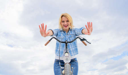 Check it out. Bicycle tricks. Woman likes to ride bike. Can everyday bicycling make you happier. Bicycling her hobby and best way to relax and reduce stress. Girl can ride her bike with no handlebars