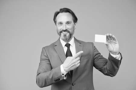 professional auditor man in formal suit. confident male manager. place for copy space. ceo in office jacket demonstrate bank credit card. mature businessman hold business card. Great day