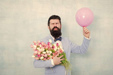 Celebrating wedding. Groom send air kiss with tulips and balloon. Celebrating wedding anniversary. Wedding flowers. Valentines day. Womens day. Flower shop. Wedding bouquet delivery