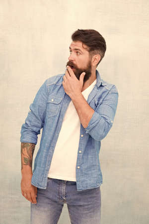 Impressed hipster. Man gasped. Shocking concept. Unbelievable emotional expression. Surprised bearded hipster cover mouth palm hand. Sincere impressed. Good impression. Fist impression