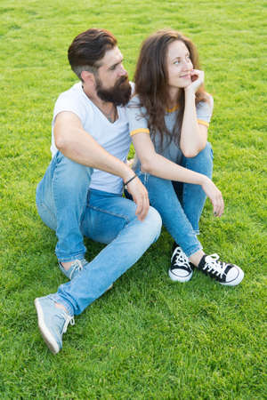Couple in love relaxing on green lawn. Simple happiness. Couple relations goals. Couple spend time in nature. Playful girlfriend and boyfriend dating. Summer vacation. Lovely couple outdoors