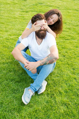 Simple happiness. Couple in love relaxing on green lawn. Playful girlfriend and boyfriend dating. Couple relations goals. Soulmates closest people. Couple spend time in nature. Lovely couple outdoors