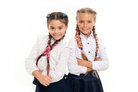 Sisters little girls with braids ready for school. School fashion concept. Be bright. School friendship. Sisterhood relationship and soulmates. On same wave. Schoolgirls wear formal school uniform