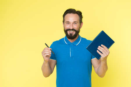 Mature hipster with beard. brutal caucasian hipster with moustache. Bearded man. Male barber care. writing new ideas. happy man with notebook and pen. Really busy. Analyzing sales pitch