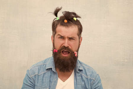 Positive amazed man. Funny portrait of man with funny hairstyle. barbershop and hairdresser. happy fathers day. charismatic hipster. Having fun party. Made for fun. comic faces and emotions