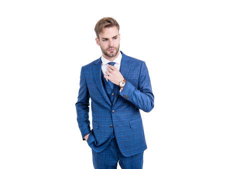 Simply dapper. Handsome man fix tie wearing navy suit. Dapper clothing. Formal wear. Trendy menswear