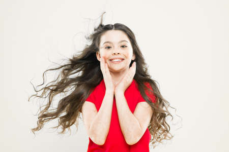 Girl adorable kid long wavy hair yellow background. Wind can also damage hair. Strong persistent winds can create tangles and snags in wavy and curly long hair. Things you doing to damage your hair