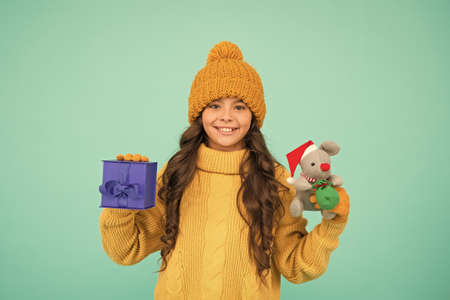 happy new 2020 year. cute santa mice toy gift. small girl hold mouse toy and present box. child knitted clothes play with toy rat. toy shop for kids. christmas is here. xmas favorite winter holiday