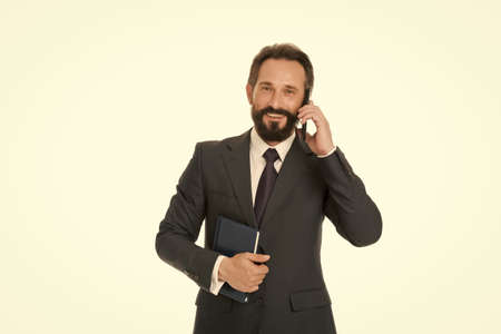 Phone call. Businessman talk on mobile phone. Bearded man use cell phone. Business communication. 3G. 4G. Mobile lifestyle. New technology. Formal work fashion. Phone for professional use