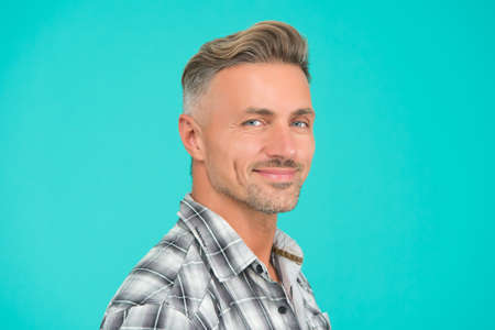 perfect male. portrait of real man. mature man unshaven face. smiling guy pleasant face. male skin and facial care. confident fashion model. barber salon services. man turquoise background Stock Photo