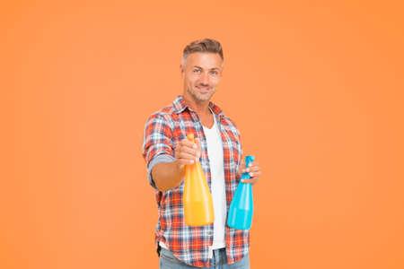 Man spray disinfectant liquid around himself, antibacterial concept Stock Photo
