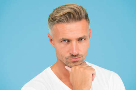 Personal care. serious well groomed guy. handsome male has perfect skin on his face. new dye haircut. graying hair coloring at hairdresser. mens beauty and health. portrait of mature man Stock Photo