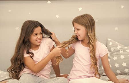 Unhand my hair. Naughty children pull on hair. Beauty look of little girls. Hair salon. Home clothing and leisure wear. Haidressing and styling. Because its my hair