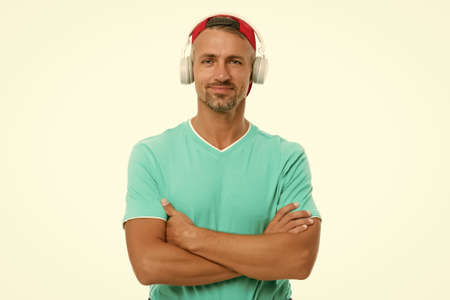 Song can explain how I feel. Unshaven man listen to song. Listening to song. Modern life. New technology. Enjoying song playing in headphones. Music and sound. Casual fashion style