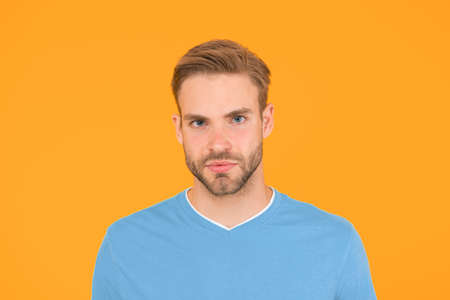 current generation. handsome man unshaven face. sexy guy yellow background. Male barber care. summer male fashion. Hair and beard care. macho man charismatic look. guy sexy and stylish bristle 版權商用圖片