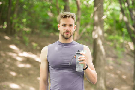 refreshment. refreshment after hart sport workout. man has refreshment with water bottle. refreshment concept and healthy lifestyle. getting refreshed.