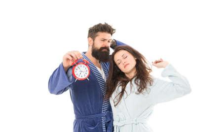 Sleepy people. Couple in love bathrobes. Sleep disorders. Drowsy and weak in morning. Morning routine. Alarm clock ringing. Couple sleepy wear clothes for sleep. Again in bad mood. Morning alarm