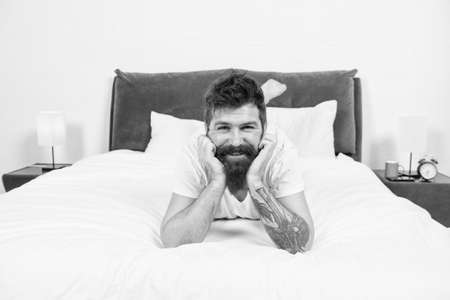 Man happy bearded face relax on bed at home, rest time concept
