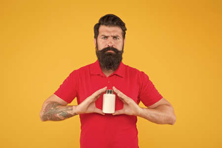 Natural organic product. Boost your overall health with these vitamins. Vitamin complex. Handsome bearded man take medication. Health care. Medicines concept. Food additives vitamins for male health 版權商用圖片