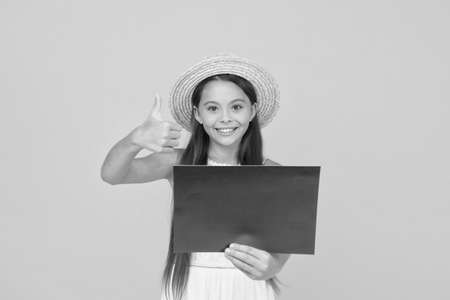 happy childhood. summer holiday and vacation. kid seasonal fashion sales. carefree beauty show paper sheet. copy space. kid in straw hat with thumb up. little child advertises beach activity