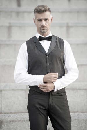 Gentleman modern style. Guy well groomed handsome bearded gentleman macho wear shirt and vest. Barber shop for groom. Confidence in his posture. Elegant gentleman. Formal party