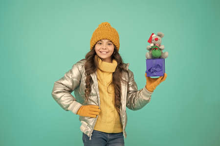 Feeling grateful for good gift. fashion kid in trendy puffer jacket. warm winter clothes. online purchase bonus. happy small girl present. shopping on xmas season. merry christmas. happy new year