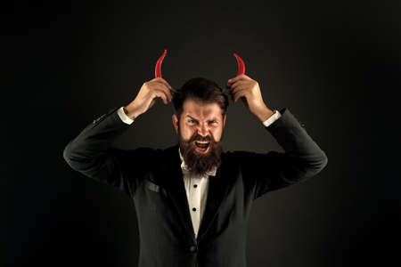 his true essence. he is devil in business. businessman has red pepper horn. barbershop hell concept. peppery male fashion. Stubborn and purposeful. brutal man prefer strong chilli. i will be demon Stock fotó
