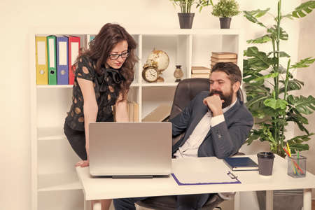 New ways to automate business processes. Managers work in modern office. Bearded man and woman use laptop. Using modern computer technologies. Running modern business. Modern life