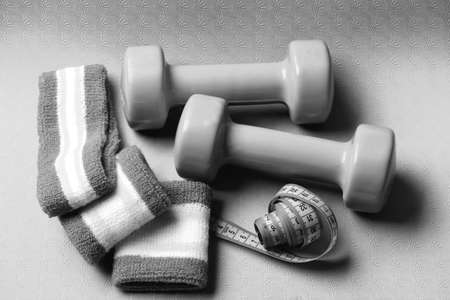 Dumbbells and measure tape and hand bands