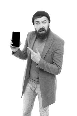 Smart communication at your fingertips. Modern bearded man pointing finger at mobile communication device. Hipster using communication technology. The next level of communication
