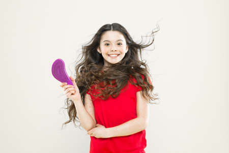 Girl adorable kid long wavy hair yellow background. Wind can also damage hair. Things you doing to damage your hair. Strong persistent winds can create tangles and snags in wavy and curly long hair