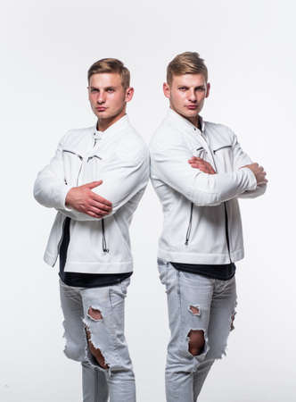 twin brothers men in white casual clothes look alike, male fashion