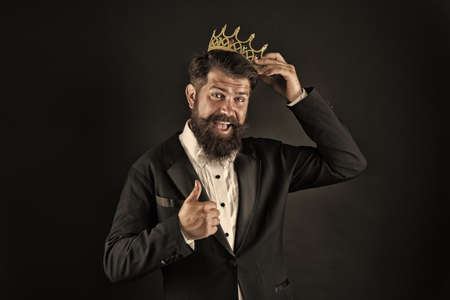 Impostor syndrome. Superiority complex. Narcissistic person. Love yourself. Sense of self importance. Responsibility being king. Handsome bearded smiling guy king. King crown. Egoist selfish man