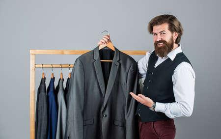 Man buy clothes fashion store menswear suit tuxedo, classic design concept