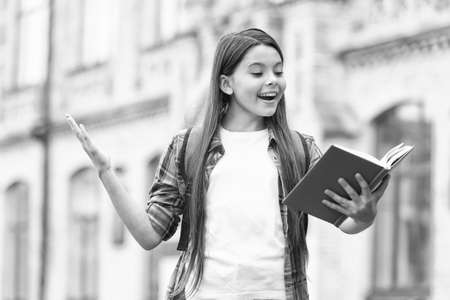 Reading is cool. Happy child read book outdoors. School library. Reading habit. Home reading. Imagination and fantasy. Literacy education. It doesnt take much to make a bookworm happy