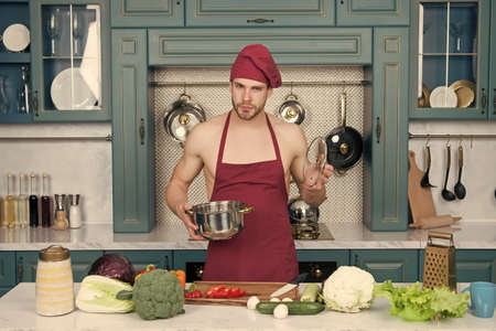 Nonviolence begins with your diet. Cooking vegetables. Vegetarianism for peace. Flavors of nature. Bearded man enjoy natural food. Attractive chef prepare veggies for cooking. Cooking healthy food Stock Photo