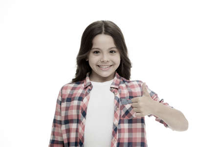 Girl smiling face feels confident. Child confidently showing thumbs up. Upbringing confidence concept. Feel so confident with parental support. I like it. Kid girl long curly hair posing confidently Imagens