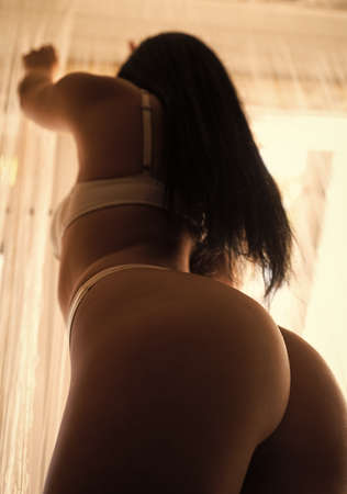 liposuction procedure. sexy hips. Buttocks of girl relax. Sensual photo of woman in bedroom. Sexual games. Womens underwear. depilation and skincare concept. female beauty salon. Beauty and fashion