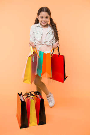 package and girl. girl with colorful package. shopping package in hand of girl. girl with package bag. little shopaholic.